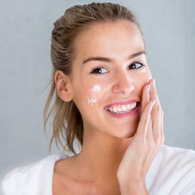 woman-using-moisturising-cream-royalty-free-image-488574651-1551280514